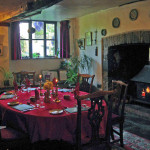 Breakfast in the medieval dining room next to a crackling log fire