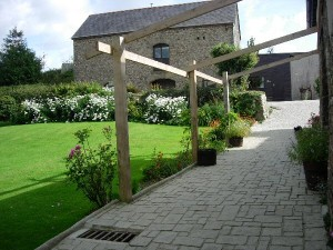 Path to converted barn with 'Swallow Barn' bedroom