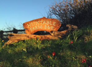 Huxtable Farm B&B sign at entrance to farm B&B lane opposite West Buckland School