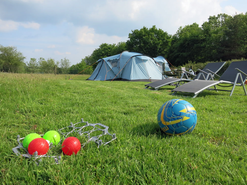Camping with plenty of space to play games & explore the farm