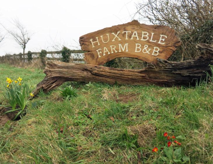Huxtable Farm B&B sign at entrance to farm opposite West Buckland public School