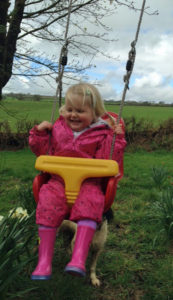 Enjoying the children's play area at Huxtable Farm B&B, West Buckland, Devon