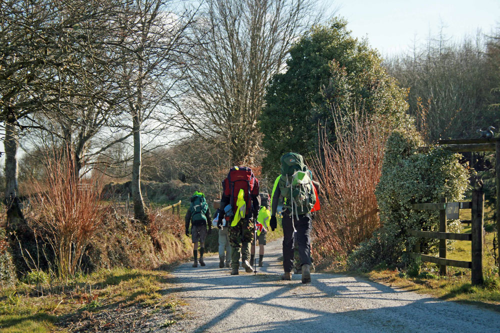 Walkers departing having camped at Huxtable Farm B&B