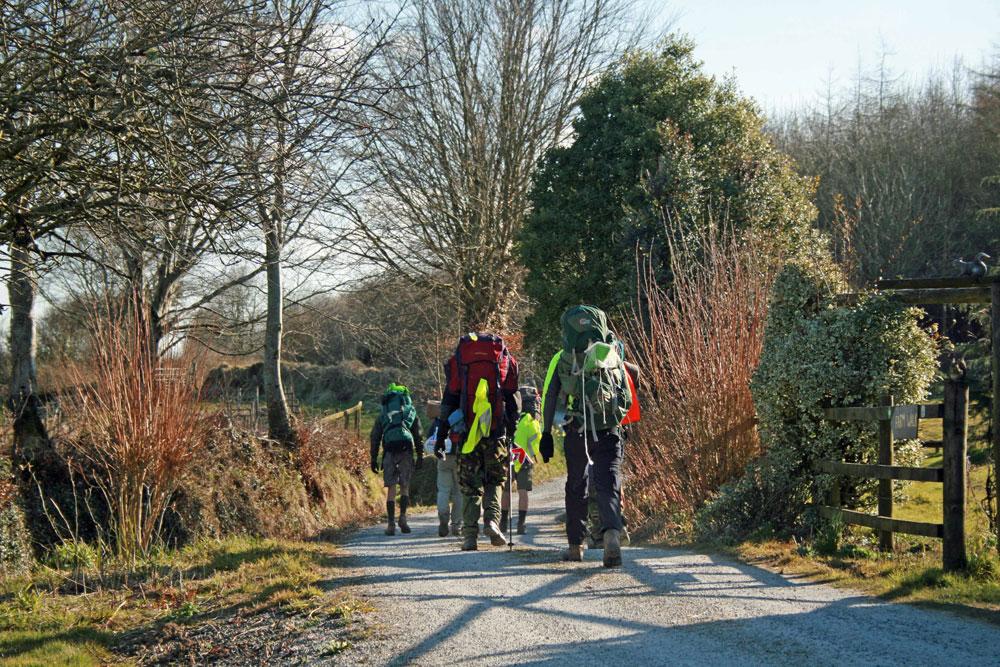 Walkers departing having camped at Huxtable Farm B&B
