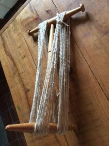 Wind spun yarn onto Niddy Noddy